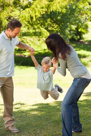 Joyful family in the park photo