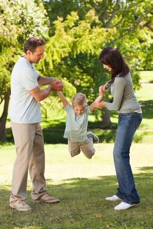 Joyful family in the park photo