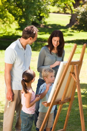 Family painting together in the park photo