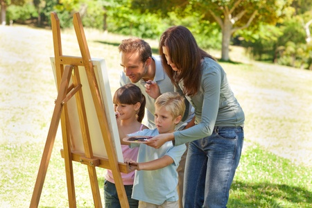 easel: Family painting together in the park