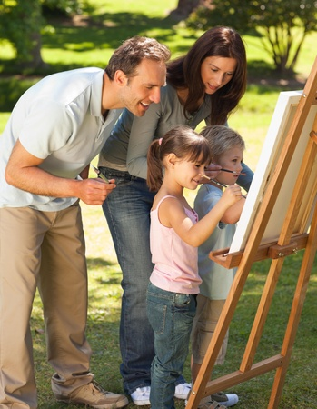 Family painting together in the park Stock Photo - 10197855