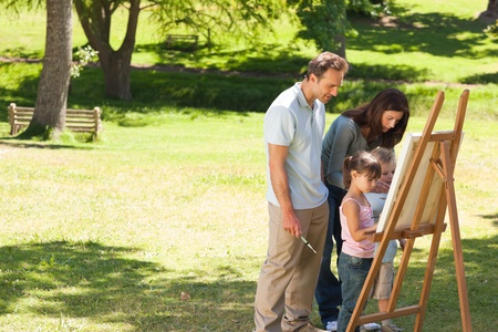 Family painting together in the park Stock Photo - 10205832