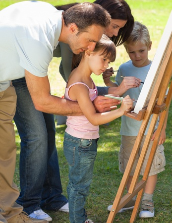 Family painting together in the park Stock Photo - 10194811