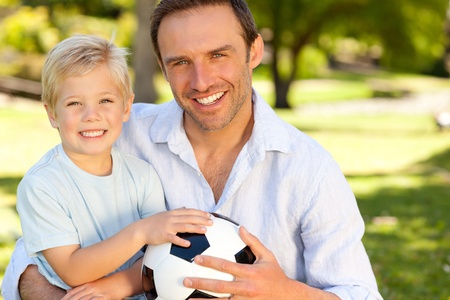 Father with his son after a football game Stock Photo - 10196108