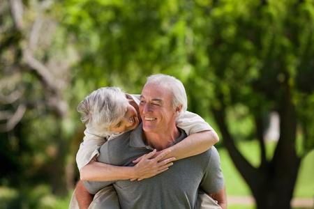 Man giving wife a piggyback Stock Photo - 10191840
