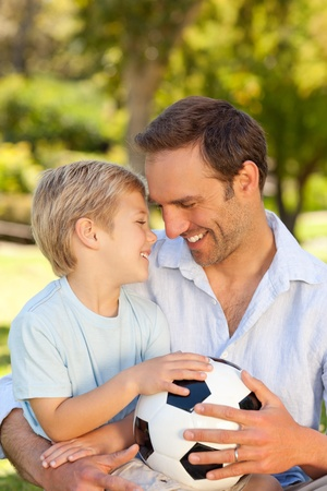 Father with his son after a football game Stock Photo - 10196246