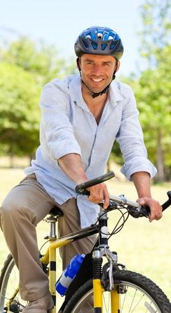 Man with his bike photo