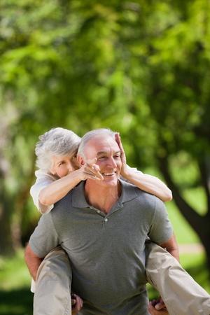 Man giving wife a piggyback Stock Photo - 10196106