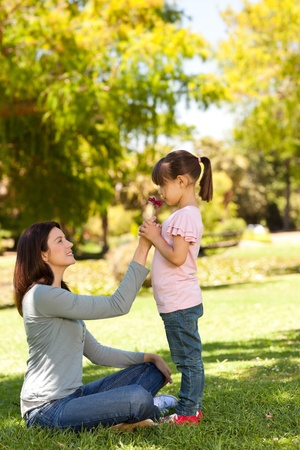 Joyful mother with her daughter in the park Stock Photo - 10219328