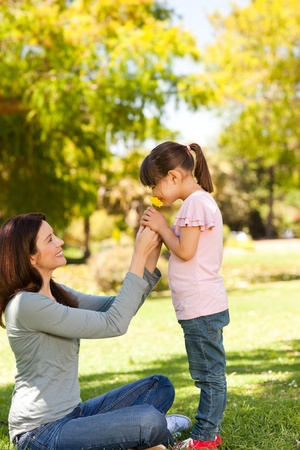 enjoy life: Beautiful mother with her daughter in the park Stock Photo