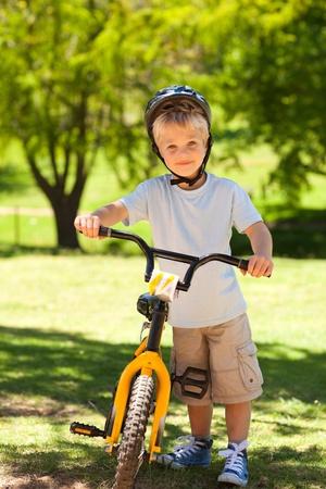 Boy with his bike photo