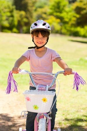 Girl with her bike photo
