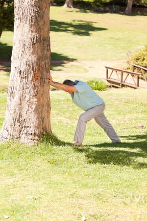 Mature man doing his streches in the park Stock Photo - 10220598