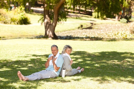 Couple after their streches in the park Stock Photo - 10219583