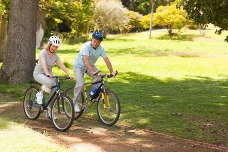 mountain biking: Retired couple mountain biking outside