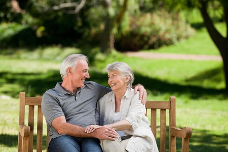 love seat: Senior couple sitting on a bench Stock Photo