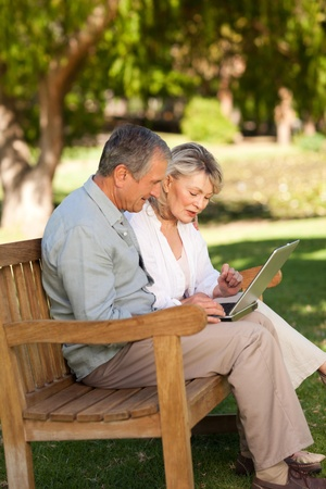Senior couple working on their laptop Stock Photo - 10216296