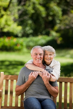 Mature couple hugging in the garden photo