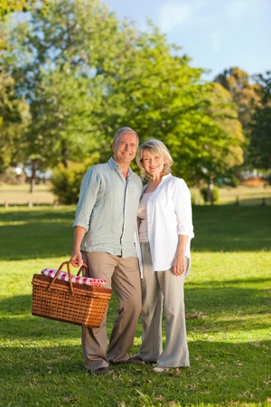 Retired couple looking for a place to  picnicking  photo