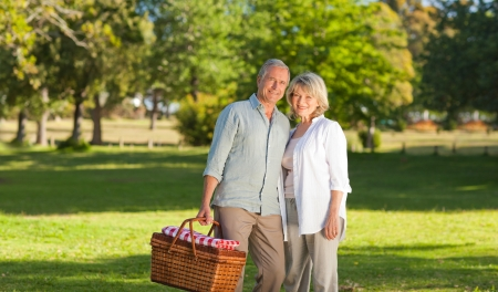 retirement age: Retired couple looking for a place to  picnicking