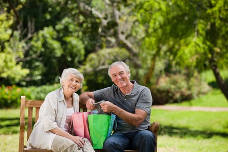 retired couple: Retired couple with shopping bags