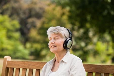 Elderly woman listening to some music photo