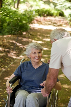 Senior couple in the woods photo
