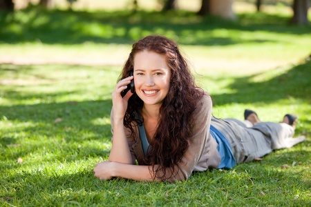 Woman phoning in the park Stock Photo - 10219706