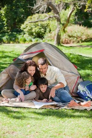 Joyful family camping photo