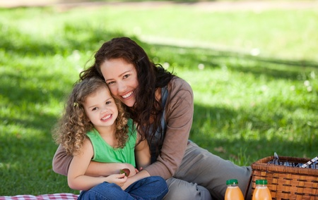 Mother and her daughter picnicking photo