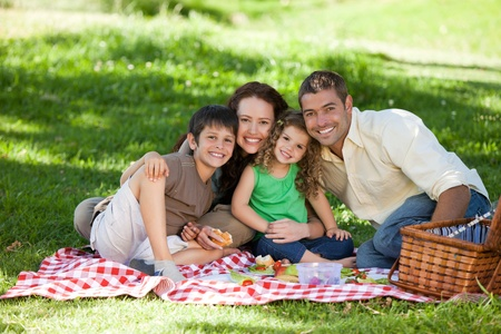 picnicking: Family  picnicking together Stock Photo