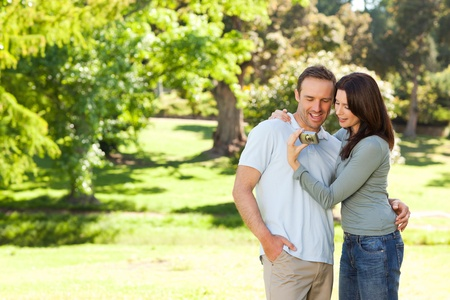 Radiant couple hugging in the park photo