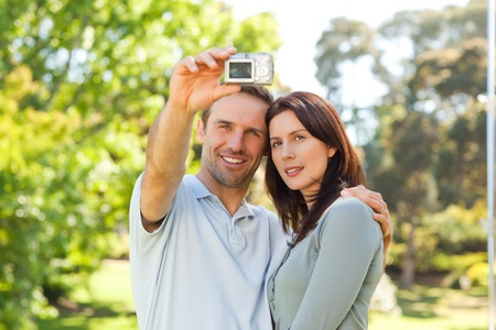 sexy photo: Couple taking a photo of themselves in the park Stock Photo
