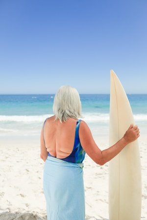Mature woman with her surfboard Stock Photo - 10213214