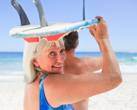 Senior couple with their surfboard Stock Photo - 10214392