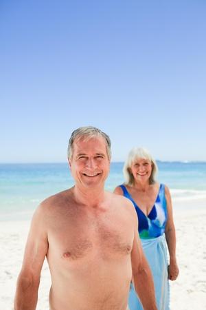 Radiant couple on the beach photo