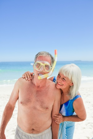 Retired couple on the beach photo