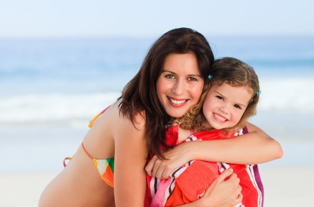 Mother with her daughter in a towel photo