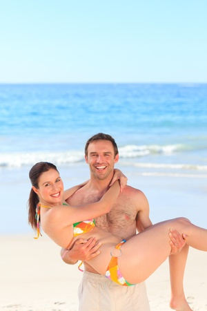 Man with his wife on the beach photo