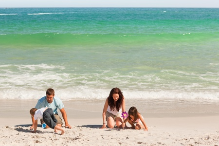 Family on the sand photo