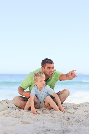 Happy father with his son at the beach photo