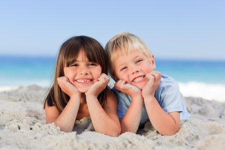 sister and brother: Children at the beach Stock Photo