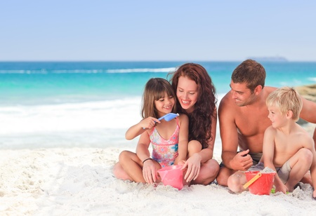 Portrait of a family at the beach Stock Photo - 10214782