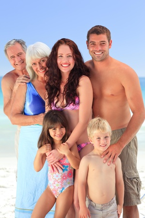 Portrait of a joyful family at the beach photo