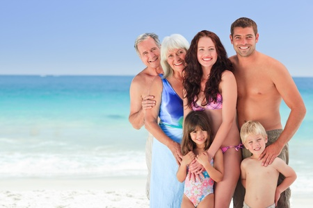 Portrait of a joyful family at the beach Stock Photo - 10216142