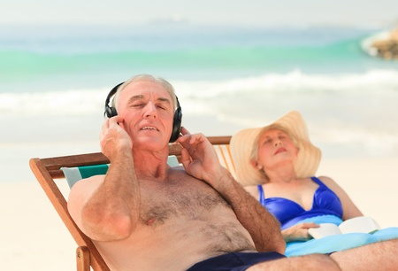 Man listening to music while his wife is sleeping photo