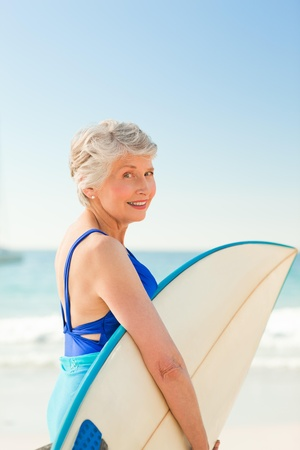 active holiday: Woman with her surfboard at the beach