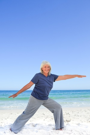 Retired woman doing her stretches photo