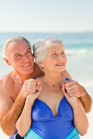 Man hugging his wife at the beach photo