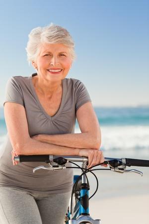 Senior woman with her bike photo